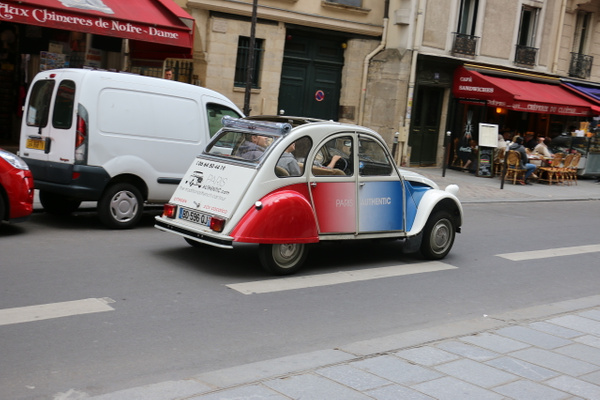 A classic Citroen zips past the Cathedral