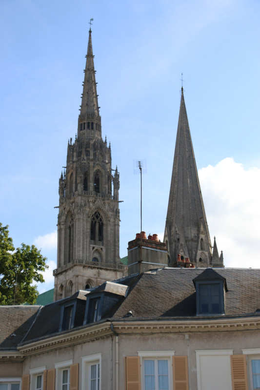 The spires of Chartres Cathedral loom over the town