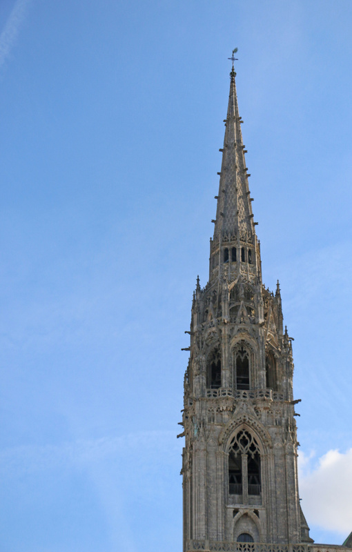 Chartres Cathedral-a 113-metre (377 ft) early 16th-century Flamboyant spire on top of an older tower