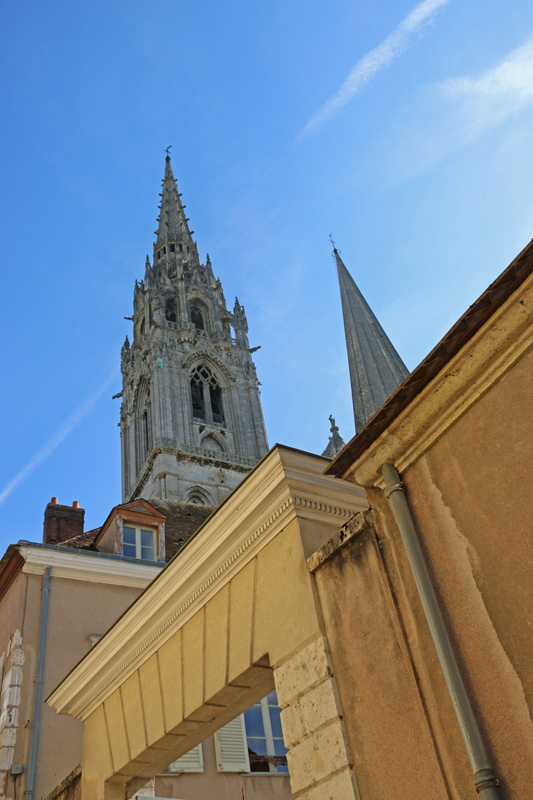 Chartres Cathedral-The flamboyant north tower in shrp contrast to the simple south tower pyramid