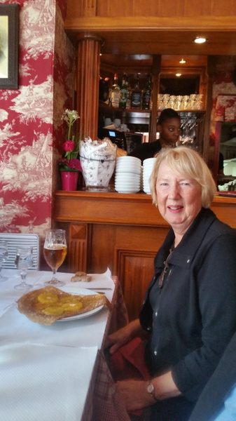 Jean beams at the prospect of enjoying her pineapple crepe
