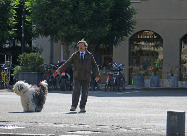 A gentleman of Chartres strolling near the Cathedral with his big shaggy dog