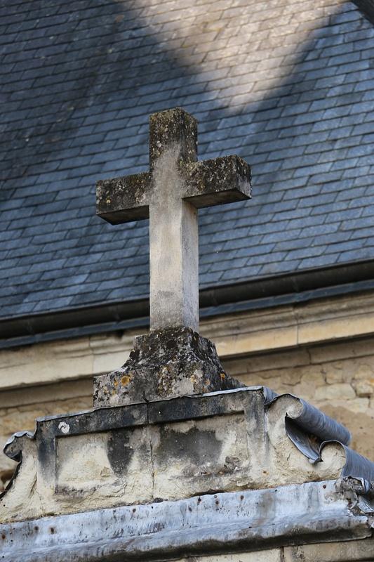 Weather beaten limestone cross