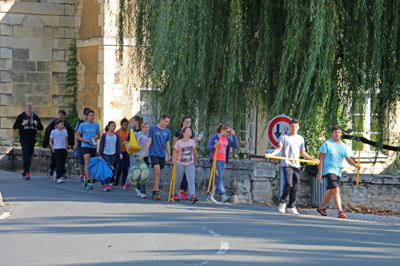 Richelieu's school children heading off play rugby, the most popular sport in southwestern France