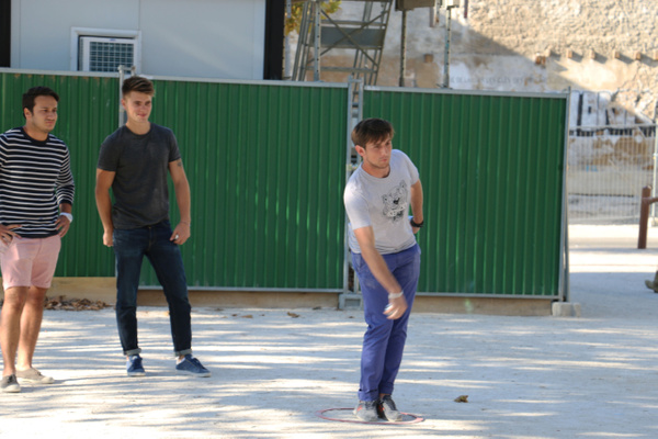 Local lads playing Pétanque. Note the players feet must not leave the circle