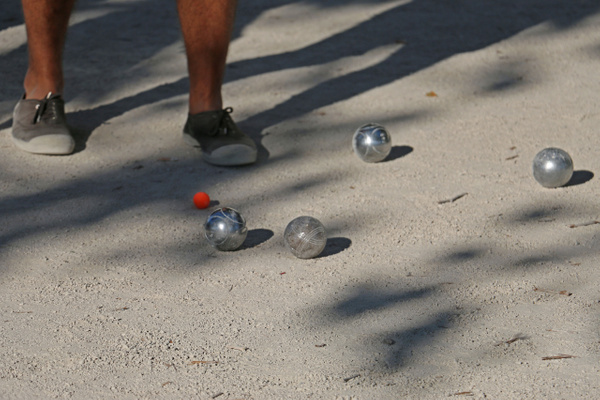 The game of Pétanque. The object is get closest to the red  cochonnet ('piglet'), or jack.