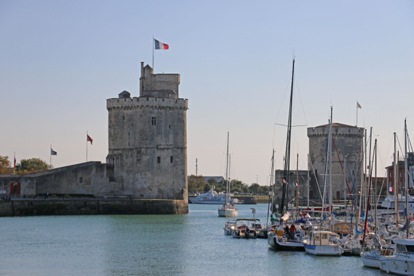 The Saint Nicolas Tower (1376) and Chaine Tower (1390) frame the inner harbor's entrance