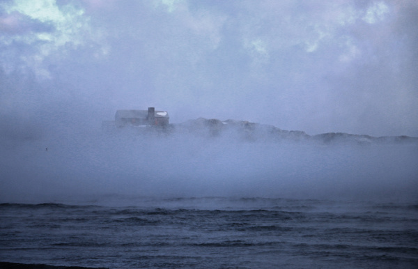 Doctor's Island off Black Rock Beach is swallowed by super-chilled fog