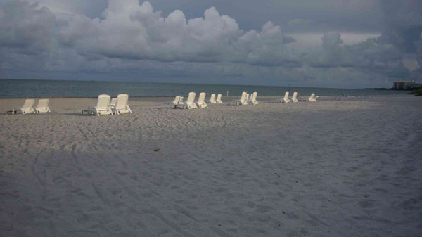 Commodore Club owned chairs on the beach by Carlos...