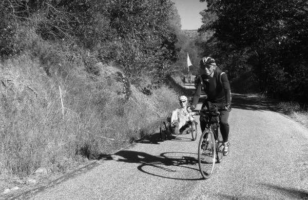 My Friend Silas on a Mountain Bike and a Cyclist on a Recumbent Bike
