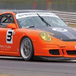 Cup car race action