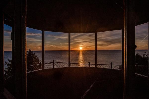 Sunset from inside Peninsula Point Light by SDNowakowski