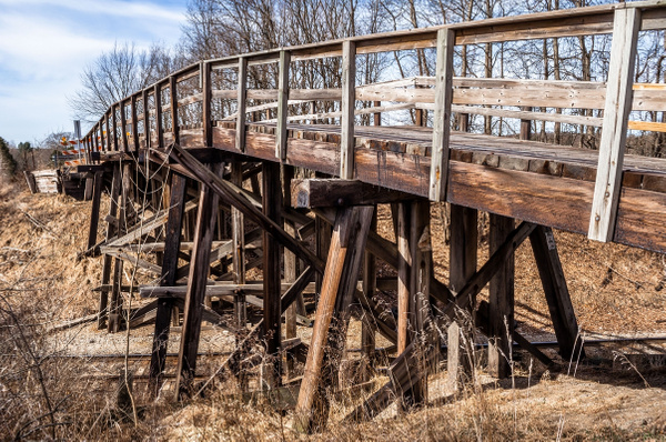 2018 An old wooden vehicle trestle over a rail line...