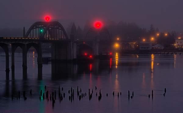 Traffic On the Bridge In Foggy Twilight