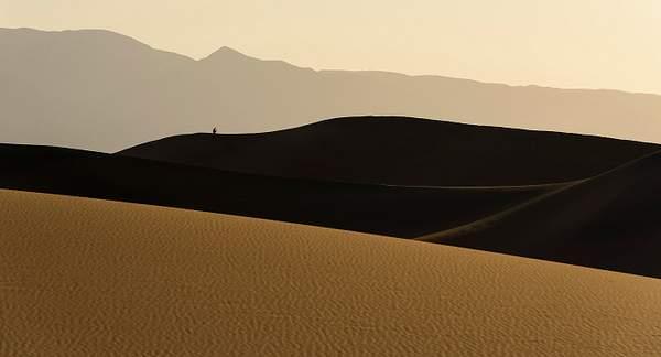 Photographer Enjoying Dawn On the Dunes