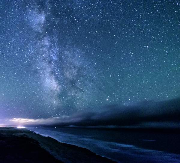 Clouds Coming In With Milky Way