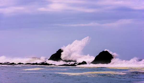 Waves hit the Rocks in High Surf