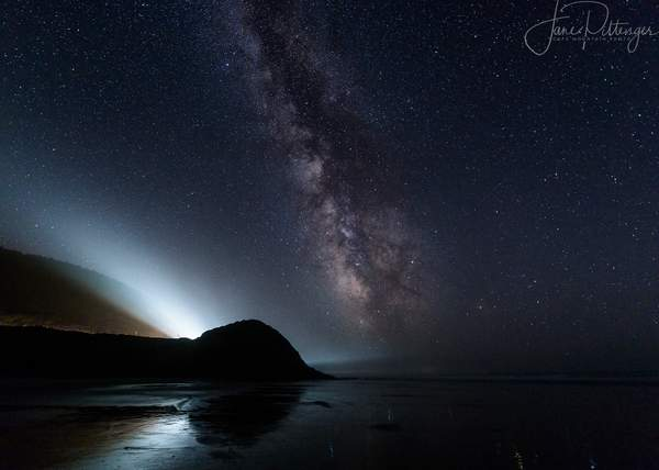 Car Beams Compete with Milky Way At Ocean Beach