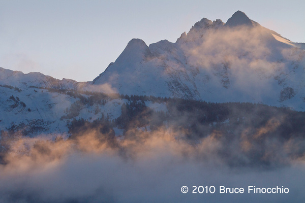 Early Morning Light Touches Fog As It Ghost Over Inside Passage Mountains by BruceFinocchio