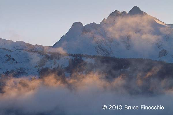 Early Morning Light Touches Fog As It Ghost Over Inside Passage Mountains