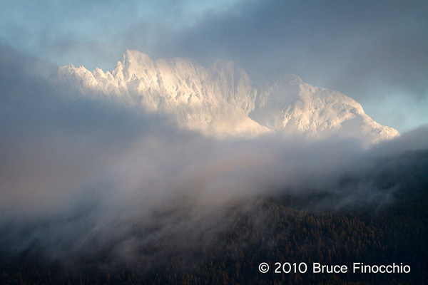 Fog Flows Over The Hills And Obscures The Mountains by...