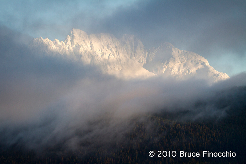 Fog Flows Over The Hills And Obscures The Mountains