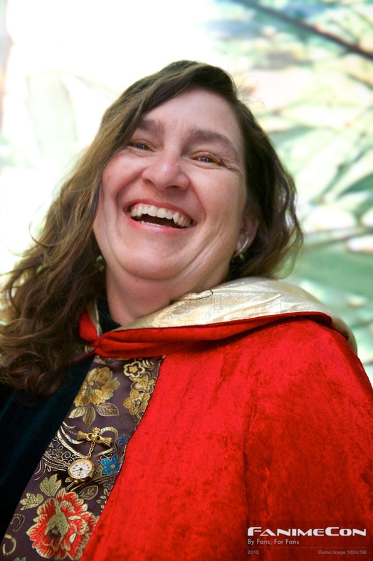 Laughing woman w red cloak n gold trim 249