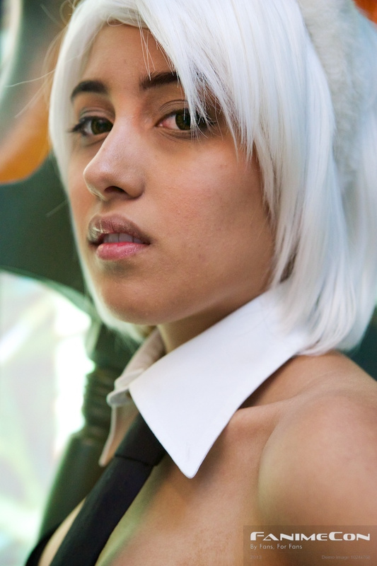 White haired woman w pink ears and big ax-close up 237