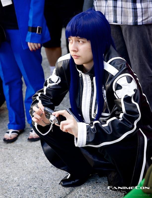Blue haired specter in black