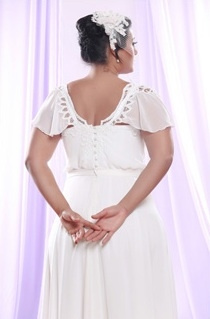 Style #PS1414 - 1650 - back of Flutter Sleeve Plus Size Wedding Dress with Empire Waist Line
