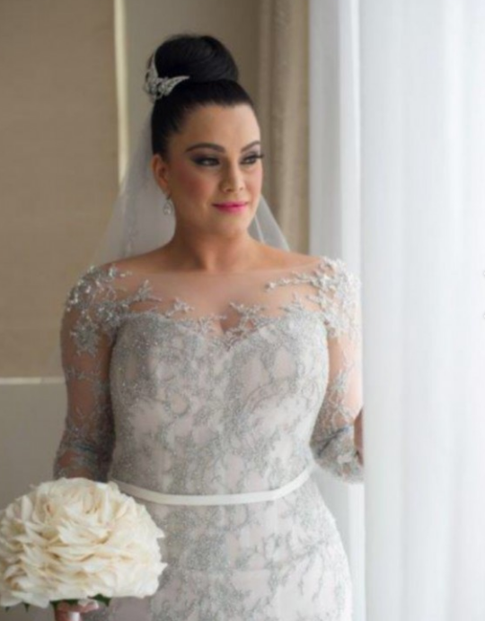 Long sleeve plus size wedding gowns with illusion neckline from Darius