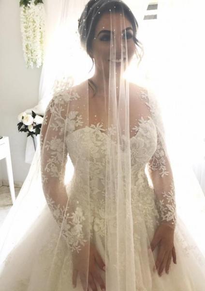 Sheer long sleeve plus size wedding dress from Darius...