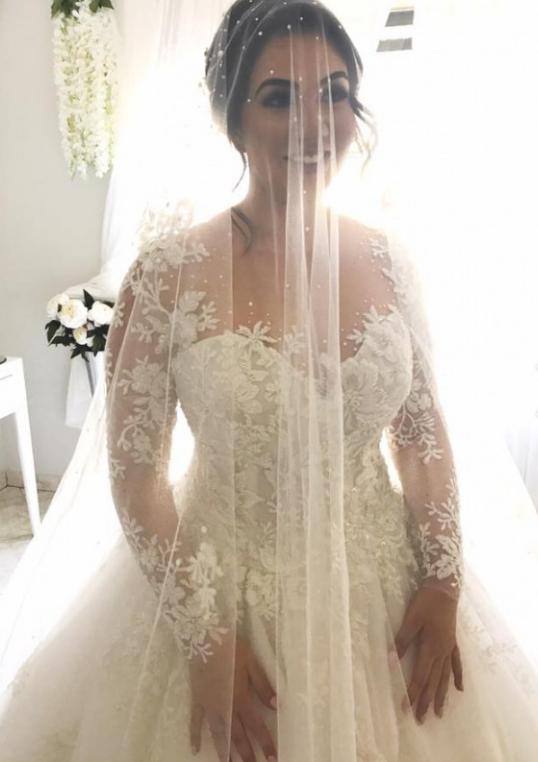 Sheer long sleeve plus size wedding dress from Darius Customs