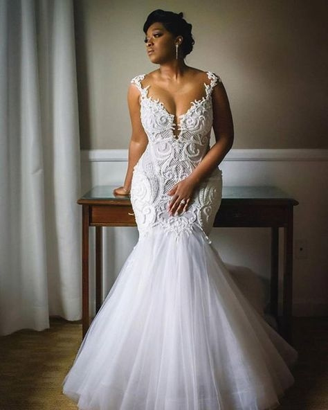 Fit-and-flare plus size wedding dresses from Darius...