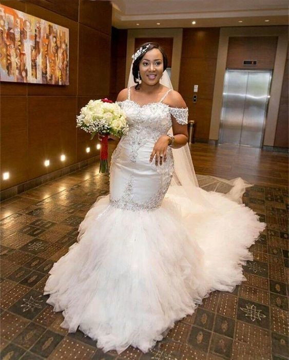 Beaded lace plus size wedding gowns from Darius Bridal