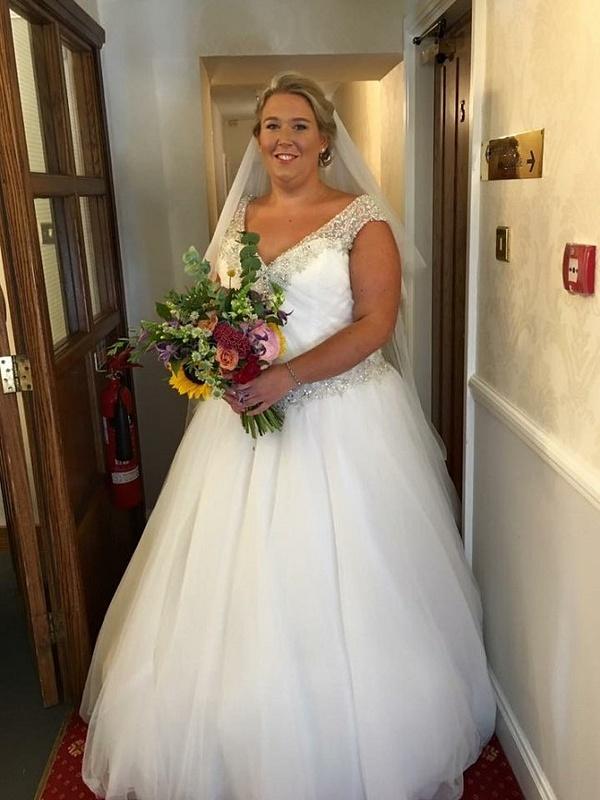V-neck line plus size bridal dresses from Darius Cordell
