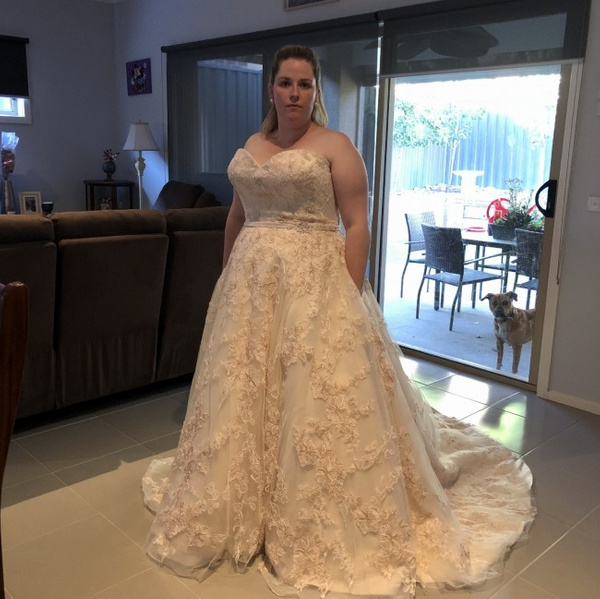 Strapless plus size bridal gown with pockets from Darius...