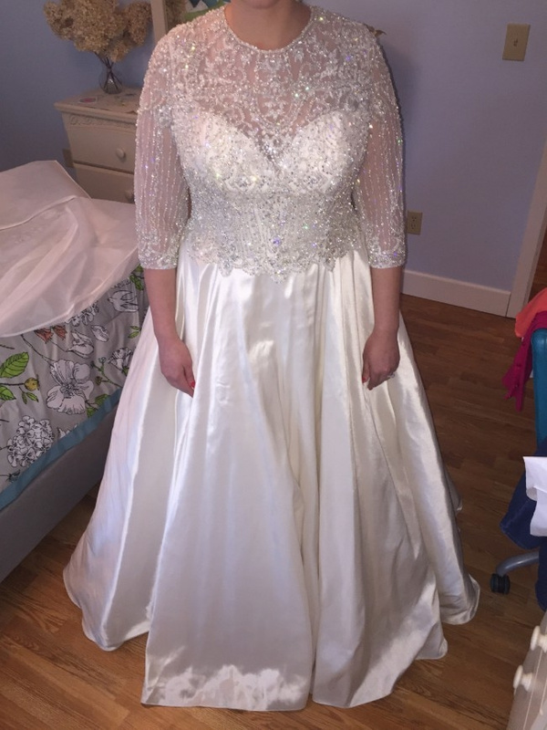 Beaded long sleeve plus size bridal gown from Darius Cordell