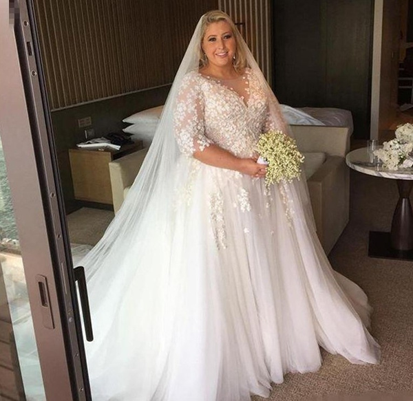 Three quarter length sleeve plus size wedding gown from...