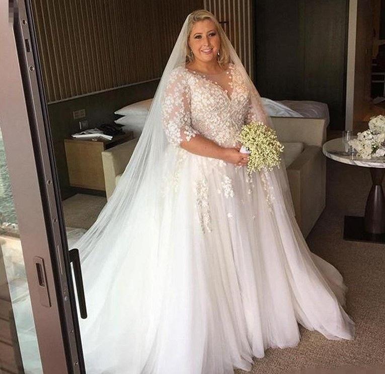 Three quarter length sleeve plus size wedding gown from Darius Bridal
