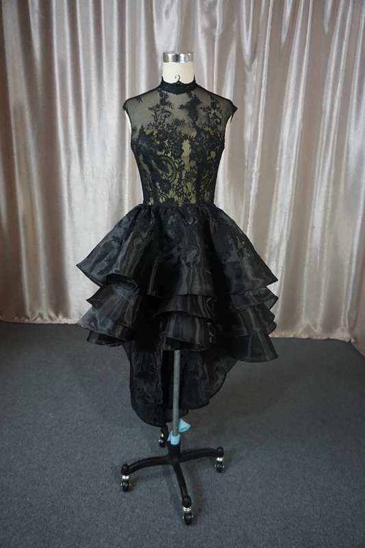 A cap sleeve black lace cocktail formal dress by Darius Cordell