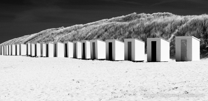 Locker-rooms on the beach on a bright sunny day