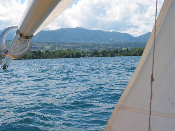 beautiful view of mountains from sailboat by Kathyemery