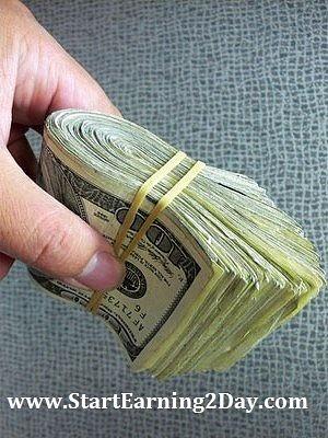 cash_wad-of-money-in-hand