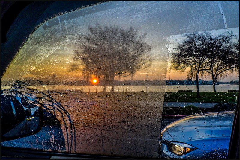 Sunrise by a car window