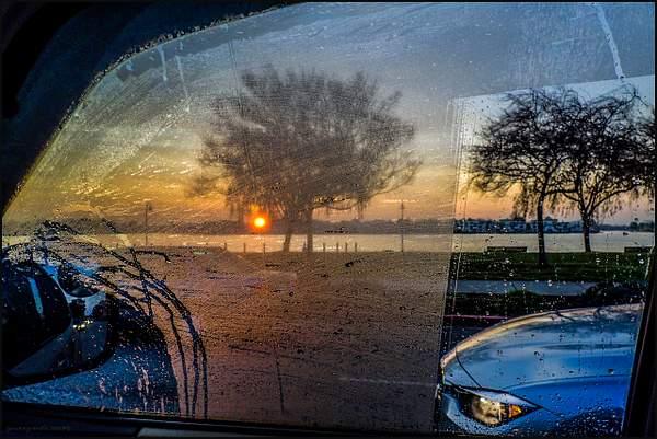 Sunrise by a car window