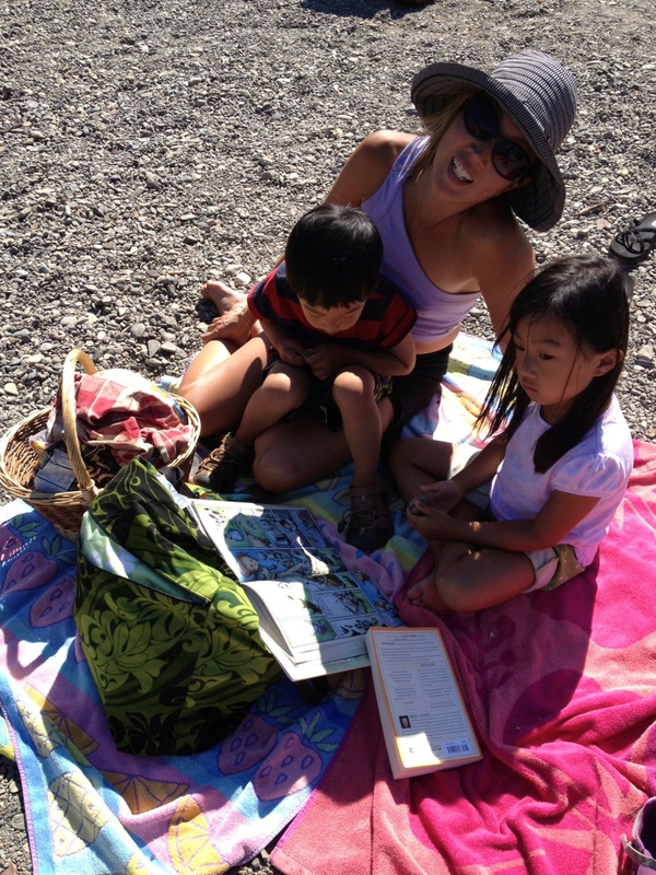 reading on the beach of  the russian river