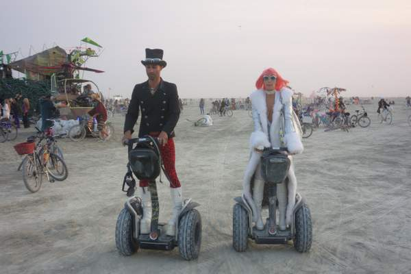 Couple on Segways at Burning Man