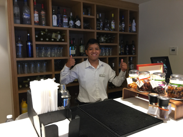 Bartender in Finest Club Lounge inside building 5 by...