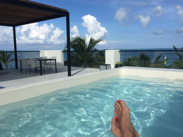 Lounging in Plunge Pool in the EC Imperial Suite by...